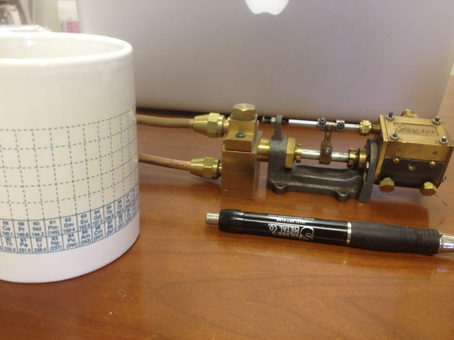 Mini duplex pump. Provides high pressure water from steam power. Amini version of a classic of the 1800s Coffee cup and pen shown for scale.