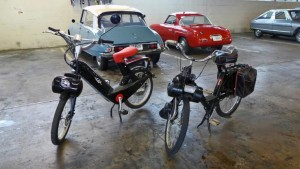 A French Solex motorcycles, and an e-Solex. The e-Solex uses a battery.