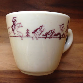Cup from the cafeteria of Amherst College shows Lord Jeff pursuing the Indians.